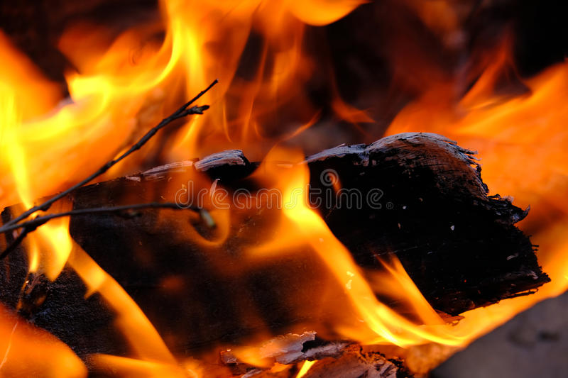 Flame shapes. Close up picture of burning firewood. True saturated colors, wonderful flame shapes bright yellow, orange and red fire tongues are dancing, high stock photography