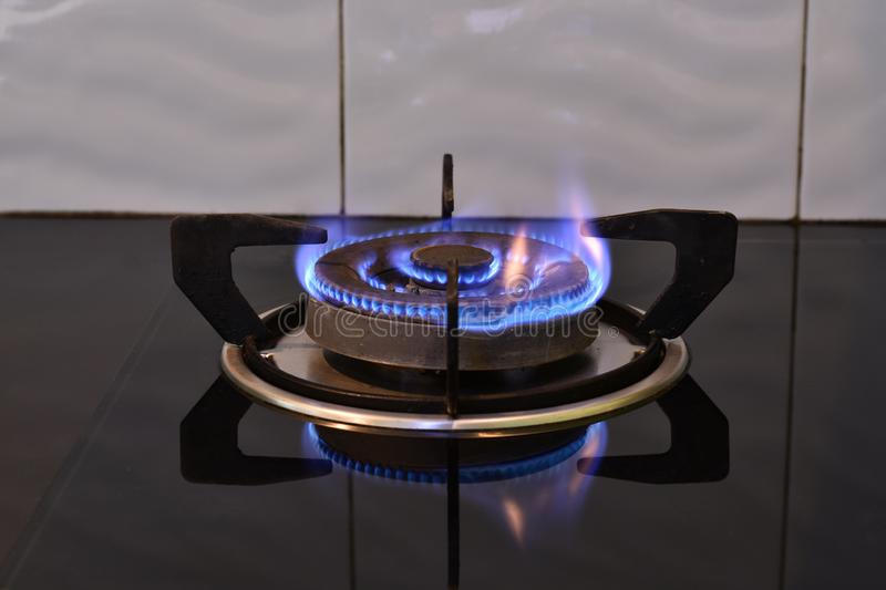 Flame on the stove royalty free stock images