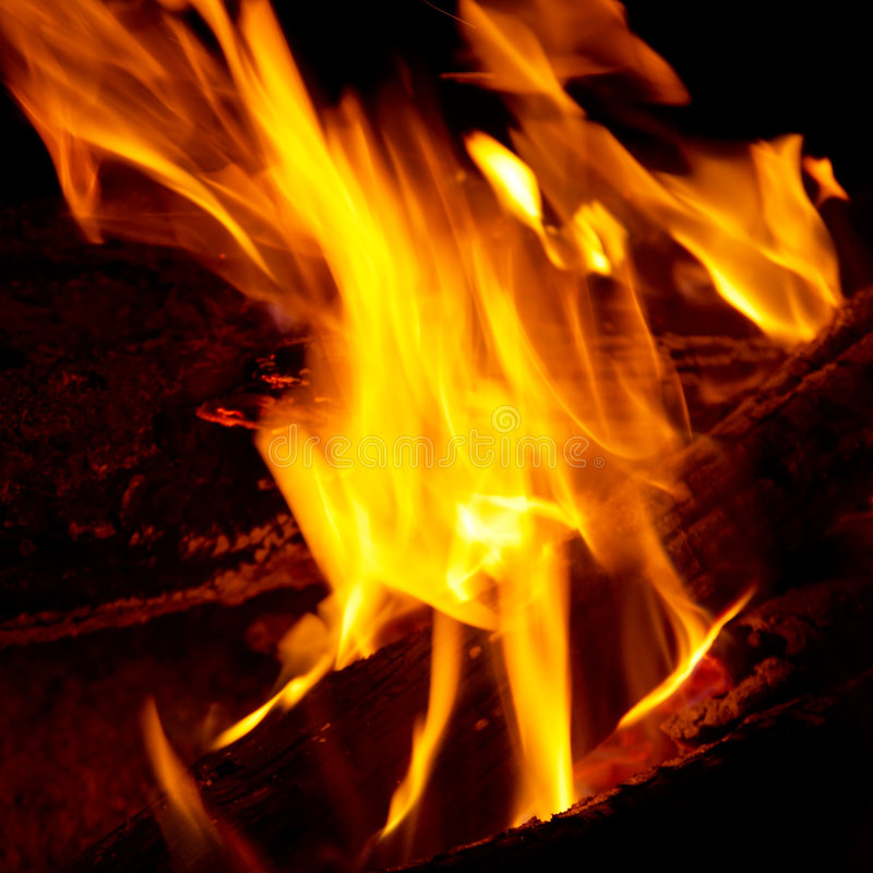 Flame Tips On The Firewood. Royalty Free Stock Photo