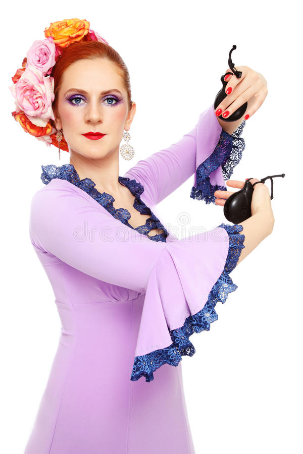 Flamenco dancer. Young attractive flamenco dancer with castanets over white background stock images