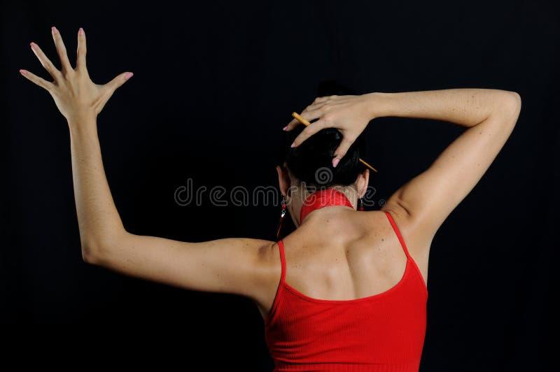 Flamenco dancer. Portrait of passionate flamenco dancer isolated on black stock photos