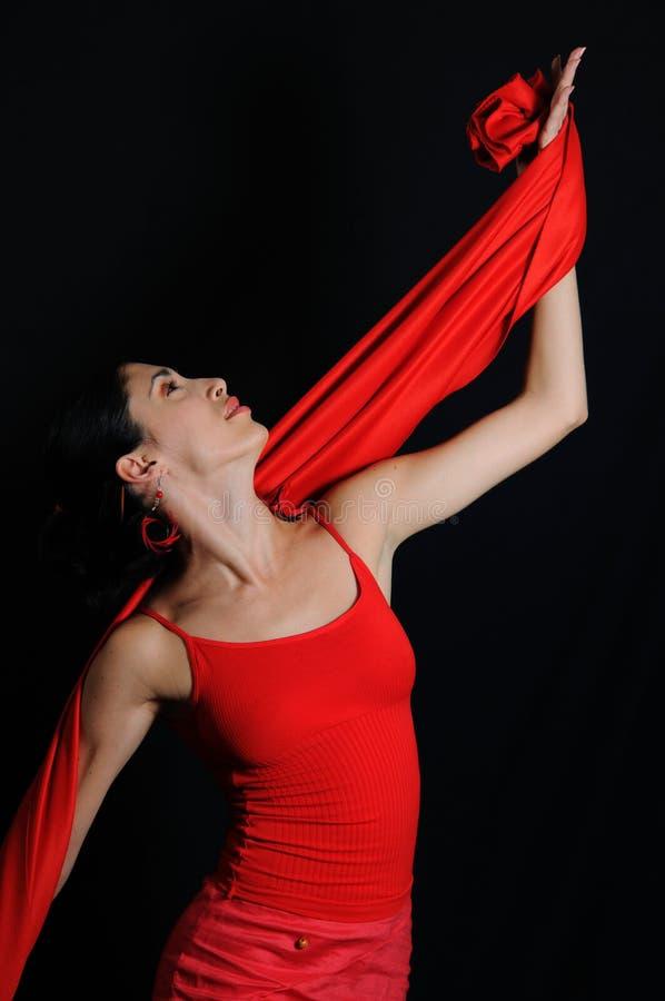 Flamenco dancer. Portrait of hispanic flamenco dancer woman isolated on black royalty free stock photo