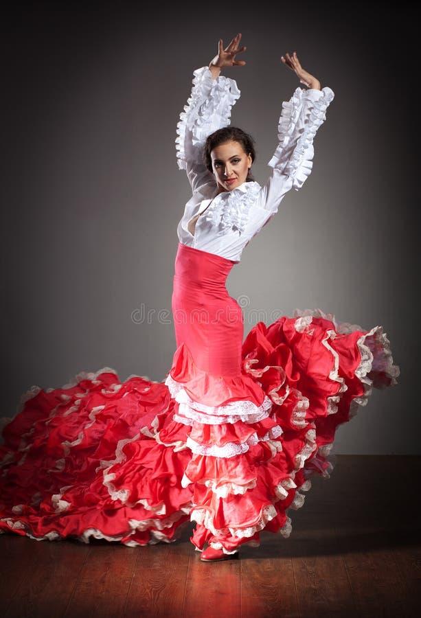 Flamenco dancer in beautiful dress. On dark background stock photography
