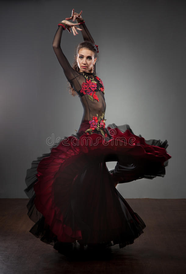 Flamenco dancer in beautiful dress. On dark background royalty free stock photo