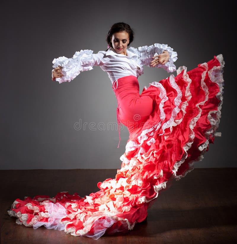 Flamenco dancer in beautiful dress. On dark background stock images