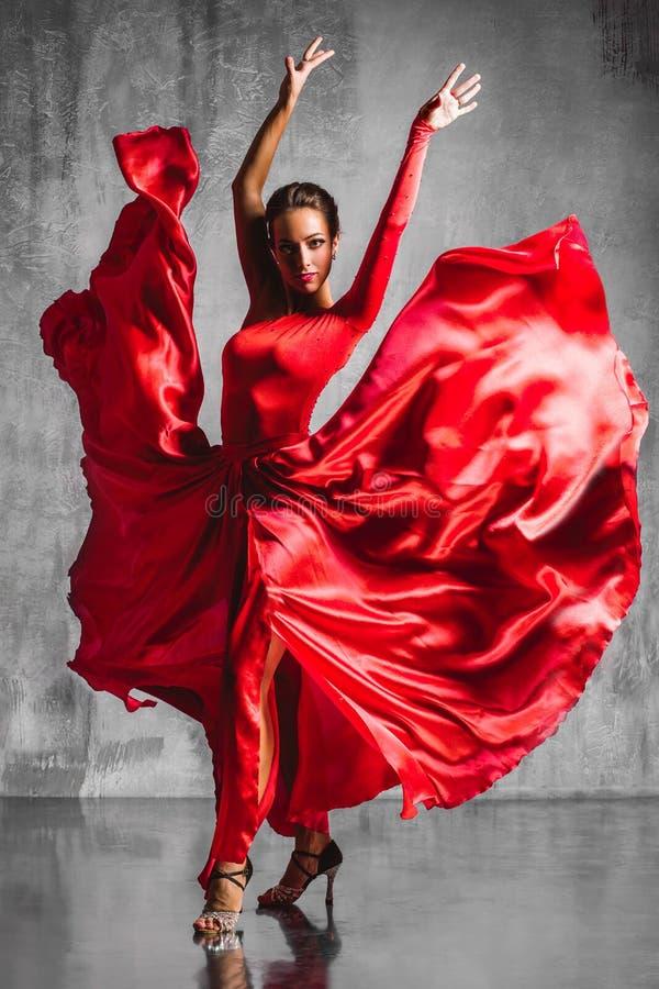 Flamenco dancer. Beautiful flamenco dancer posing on a studio background stock photography
