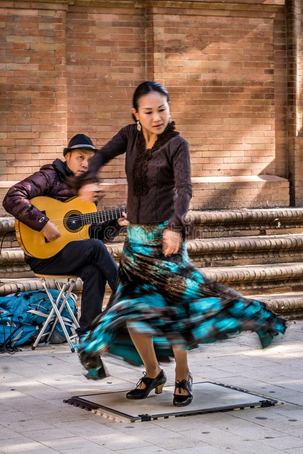Flamenco dancer in motion and guitarist royalty free stock image