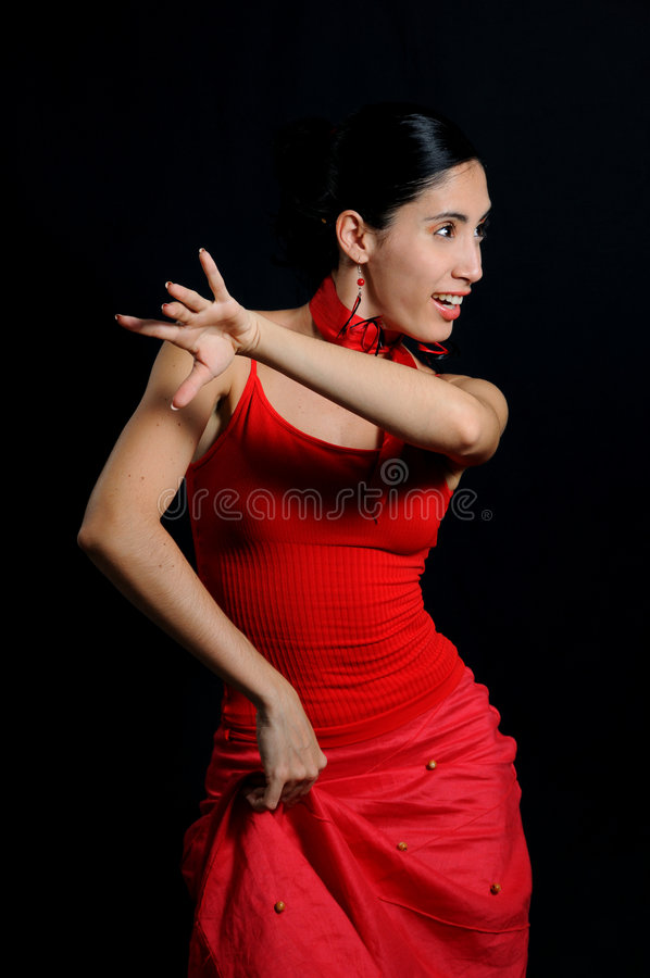 Flamenco dancer isoated. Portrait of passionate flamenco dancer isolated on black royalty free stock image