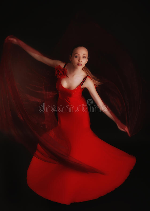 Flamenco dancer in red dress with veil stock photos