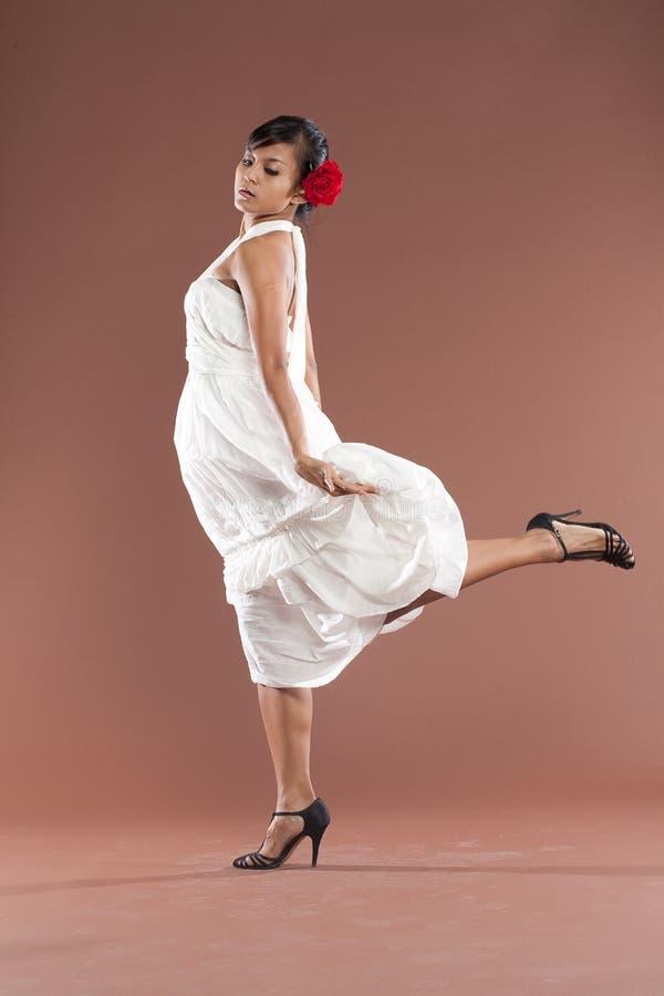 Flamenco dancer in white dress stock photography