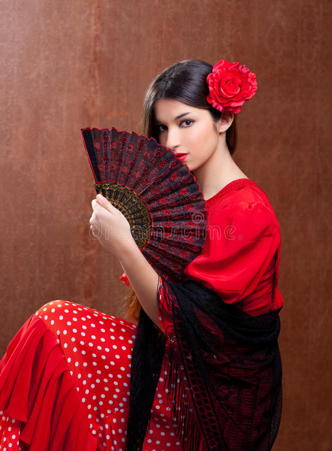 Flamenco dancer woman gipsy red rose spanish fan. Flamenco dancer Spain woman gipsy with red rose and spanish hand fan royalty free stock photography