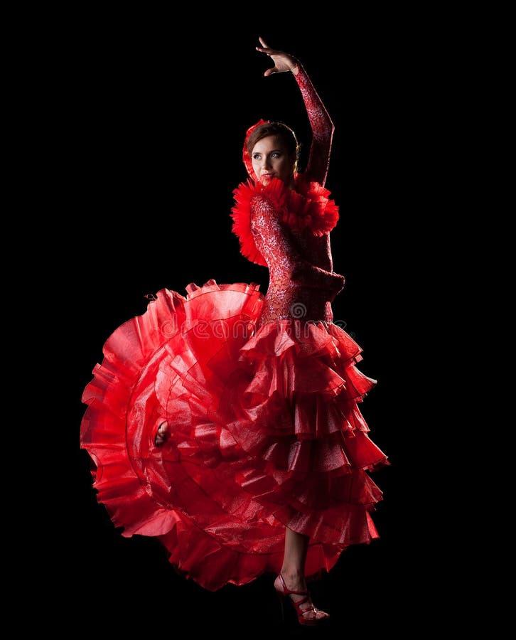 Flamenco de l'Espagne de danse de femme dans le costume oriental rouge photos stock