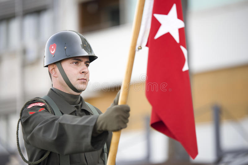 Flament carrying soldier. Izmir, Turkey - October 29, 2016. Soldier is carrying a flament at ceremony of Republic day of Turkey October 29th 2016 royalty free stock photo