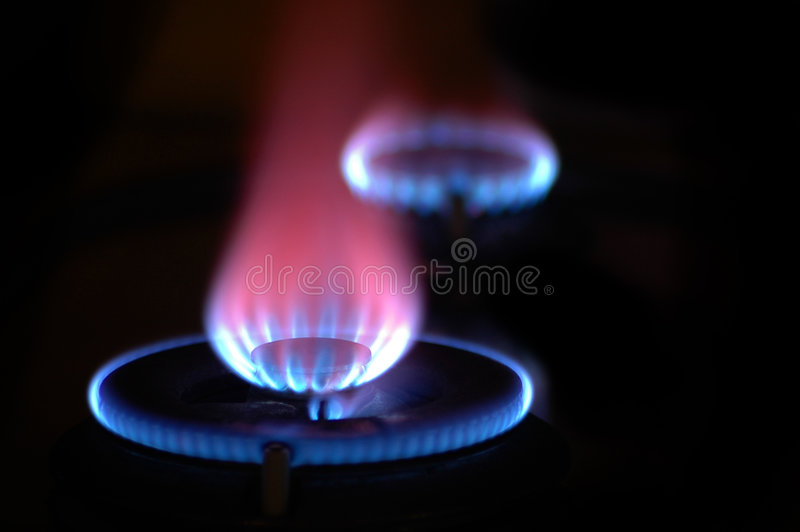 Flames from 2 Stoves stock images
