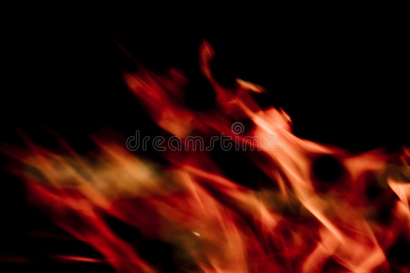 Flames on black background stock images