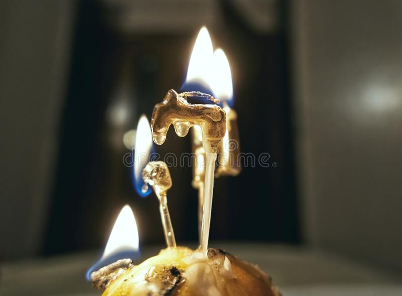 Flames of burning birthday letter candles close up. Close up view of flames of burning birthday letter candles stock image
