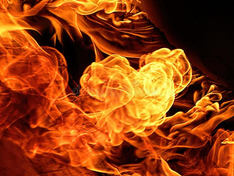 Flames. Can be caused in an inferno, a torching, a scorching hot day, arson, combustion, explosion, torchin, arson, inflammatory, ignition, charred wood which royalty free stock photos