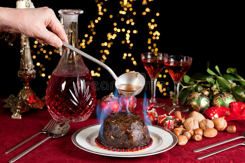 Flames on the christmas pudding stock image