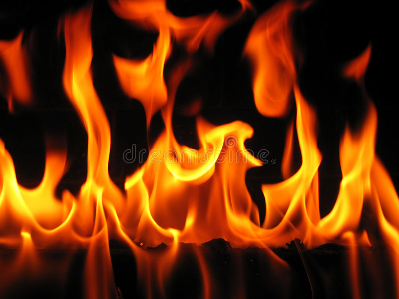 Flames coming from a log stock photos