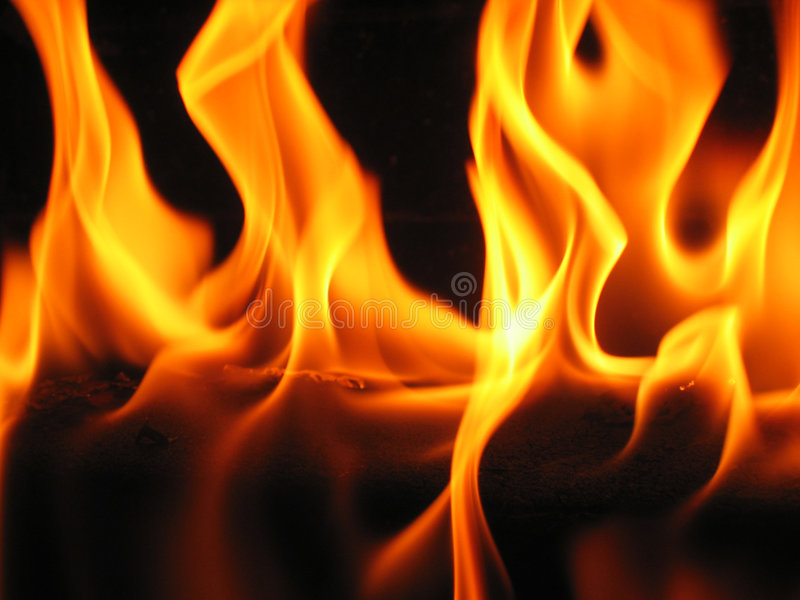 Flames coming from a log stock photography