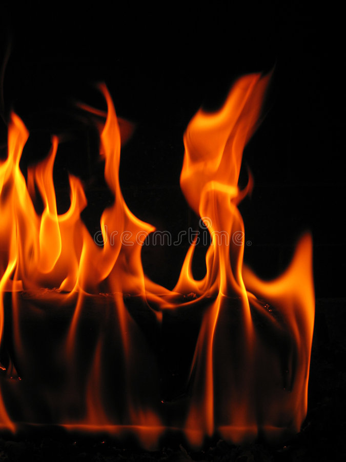 Flames coming from a log on fire royalty free stock images