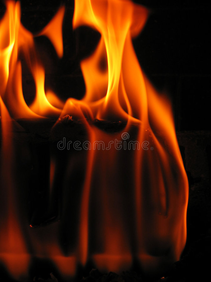 Flames coming from a log on fire stock photo