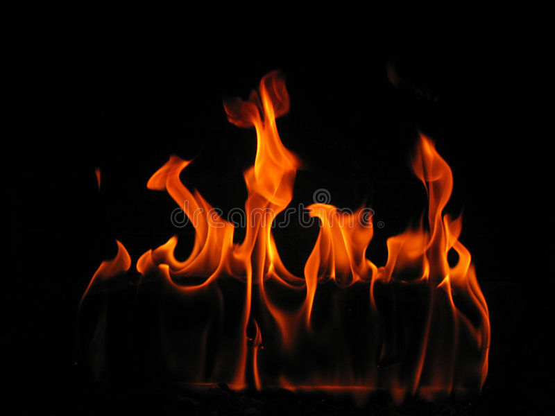 Flames coming from a log on fire stock image