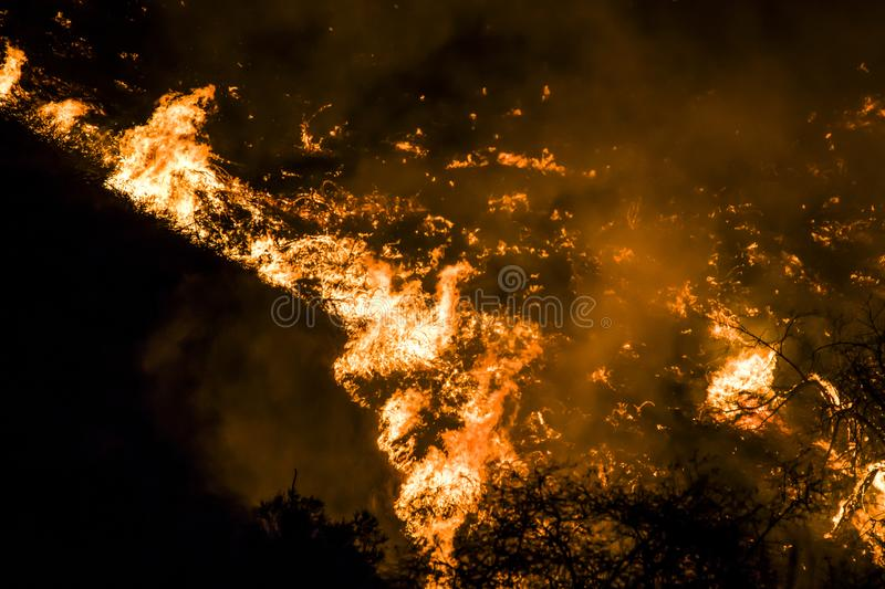 Close up Flames and Embers at Night Twist into Tornado Shape During California Fire stock photo