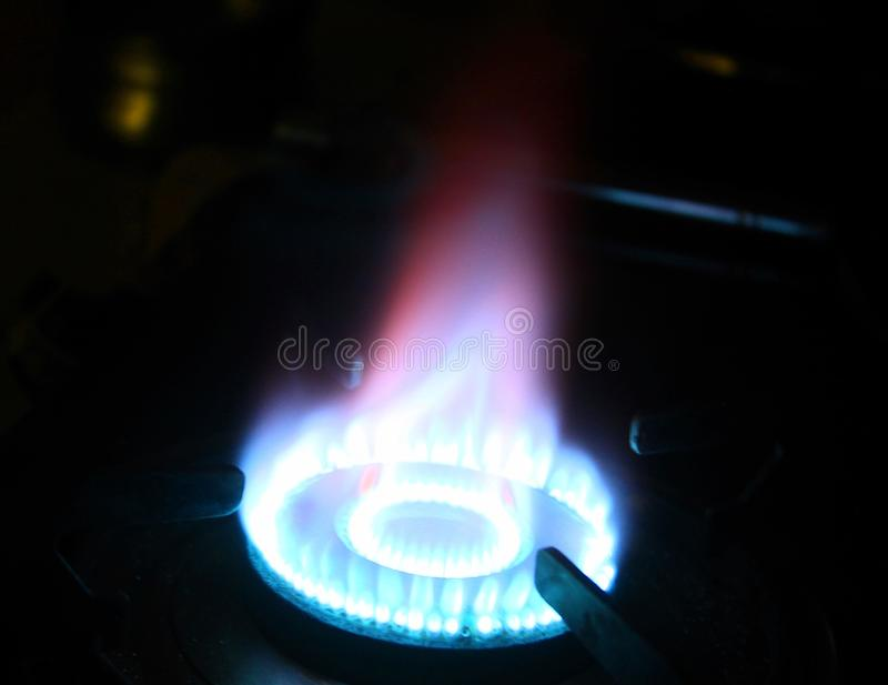 Flames on a gas stove in dark royalty free stock images