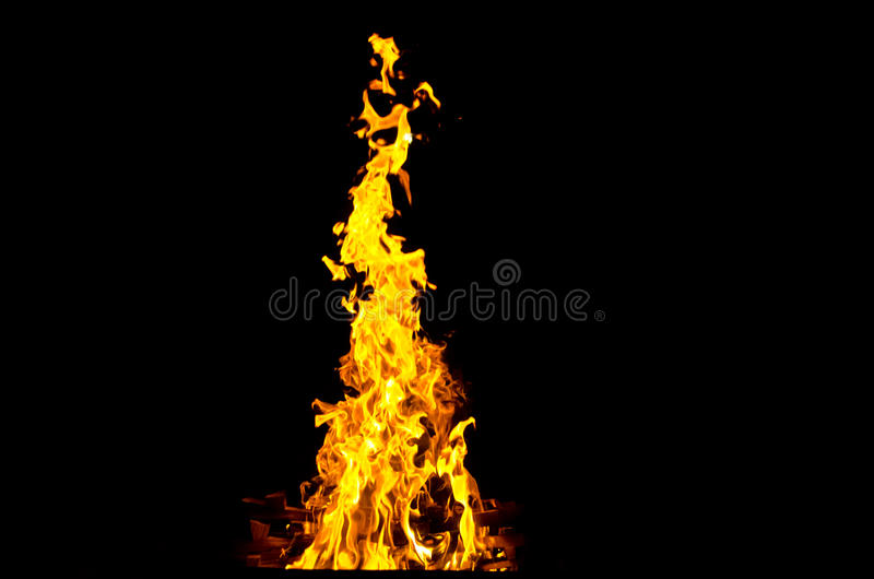 Flames lit the fire, warming his warmth in cold weather. Rules of safe breeding of fire. royalty free stock photo