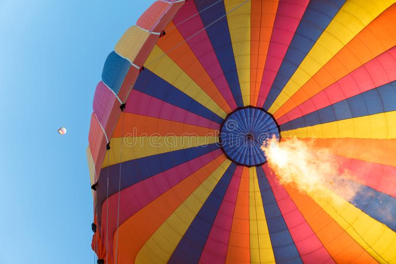 Flames rising in a hot air balloon royalty free stock images