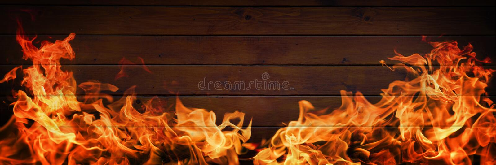 Flames on wooden background stock photography