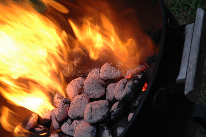 Flaming charcoals in kettle royalty free stock photos