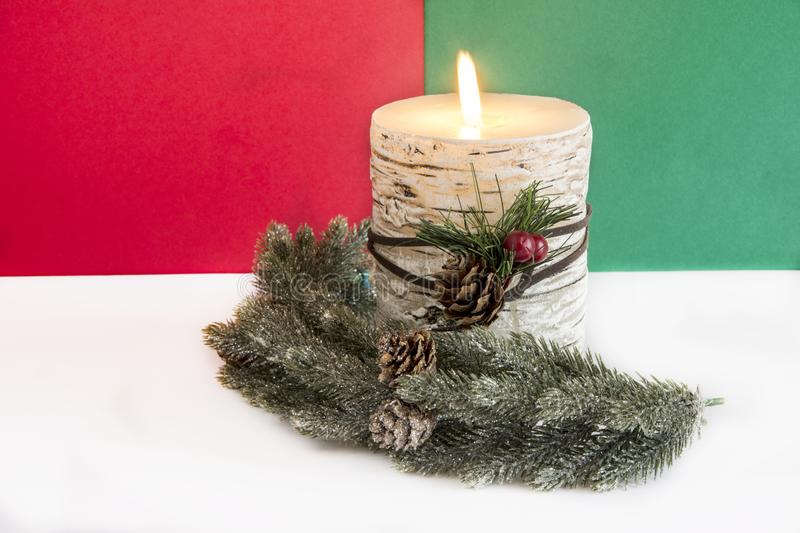 Flaming Christmas candle stock image