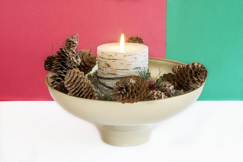 Flaming Christmas candle royalty free stock image