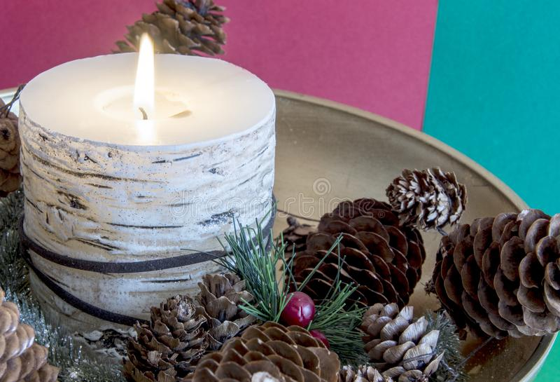 Flaming Christmas candle royalty free stock photo