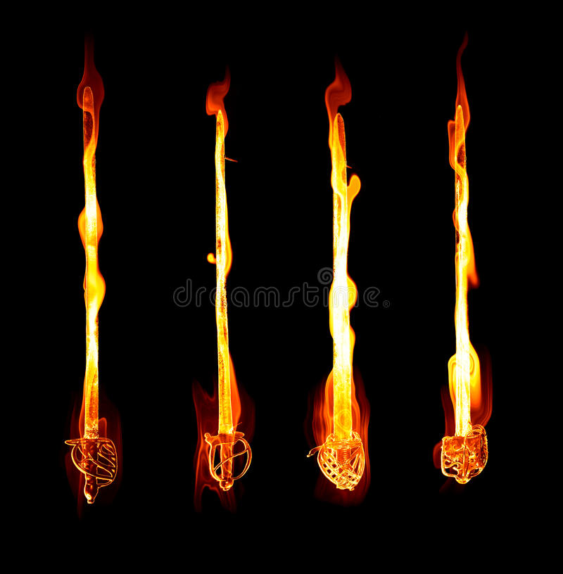 Flaming fiery swords. Great image of four fiery or flaming swords royalty free stock images