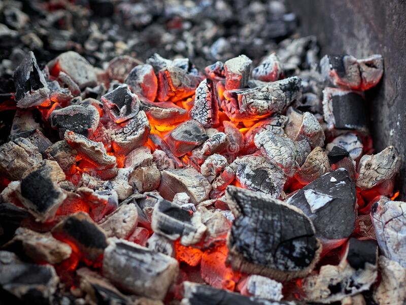 Flaming Hot Charcoal In Barbeque Grill royalty free stock photography