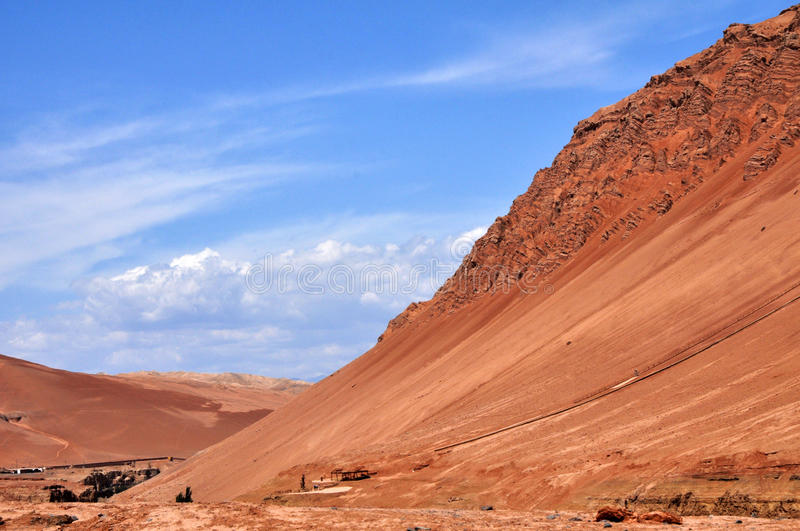 The flaming mountain. There was a famous mountain in the Chinese story , named Flaming Mountain. in fact, the mountain is real, right lie on the city of Turpan stock photo