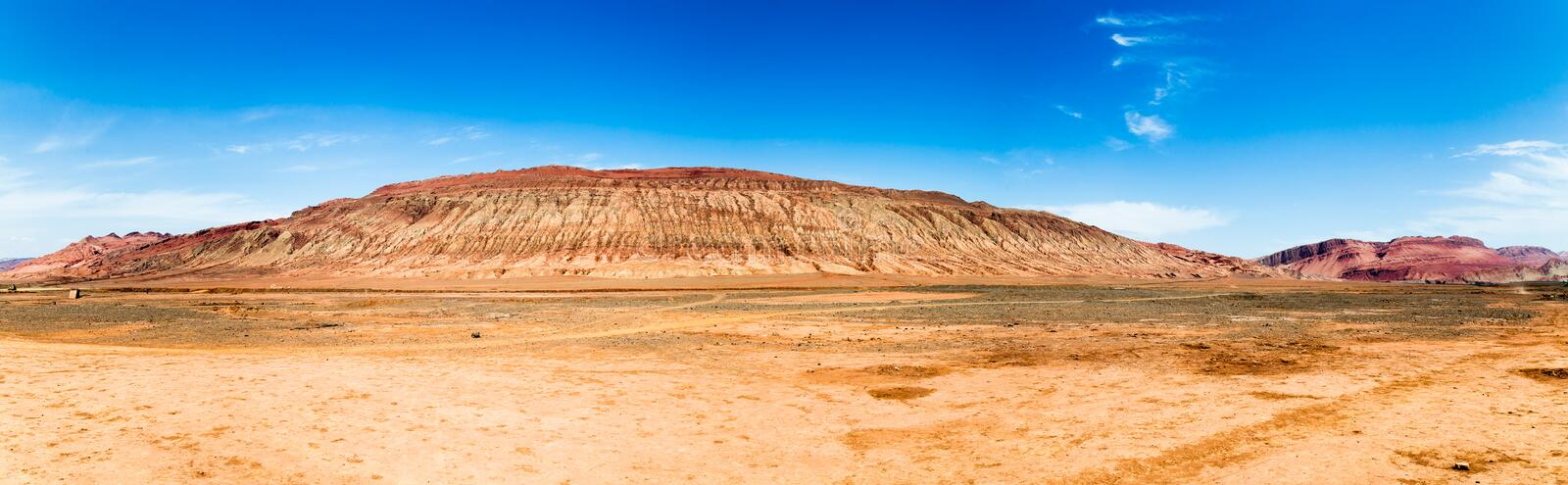 """Flaming mountains, Turpan, Xinjiang, China: these intense red mountains appear in the Chinese epic """"Journey to the west"""". Flaming mountains, Turpan royalty free stock images"""