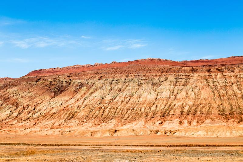 """Flaming mountains, Turpan, Xinjiang, China: these intense red mountains appear in the Chinese epic """"Journey to the west"""". Flaming mountains, Turpan stock photos"""