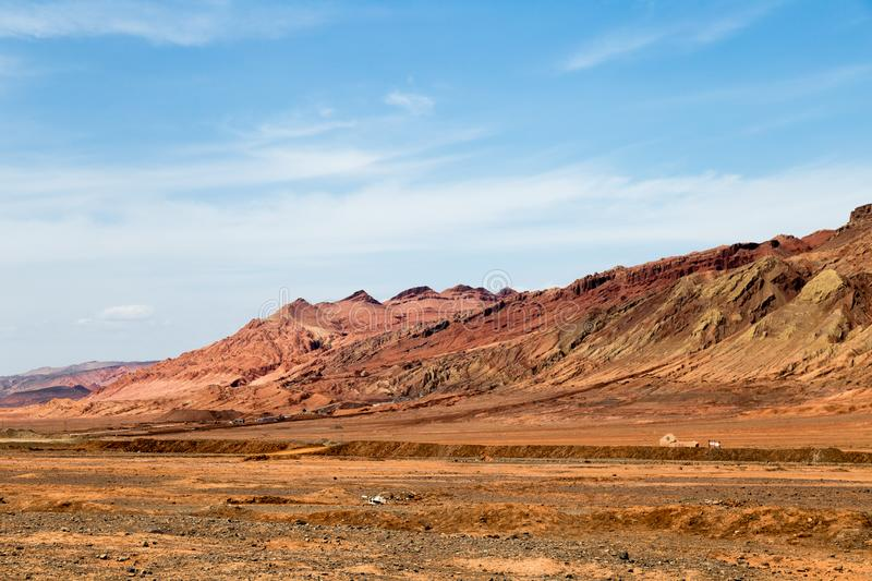 """Flaming mountains, Turpan, Xinjiang, China: these intense red mountains appear in the Chinese epic """"Journey to the west"""". Flaming mountains, Turpan stock image"""