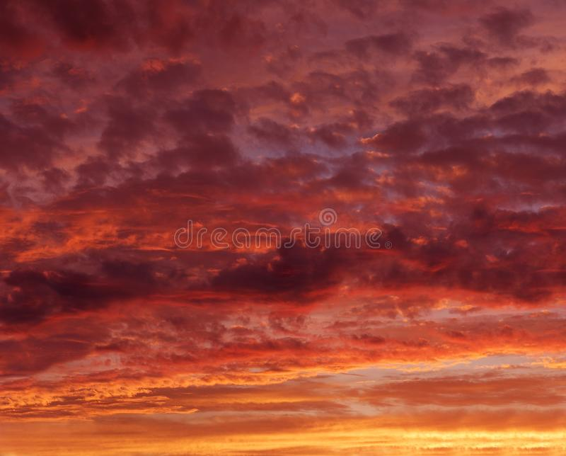 Flaming red orange sky at the evening twilight, orange sunset, colourful sunset, eartistic photo of evening twilight stock images