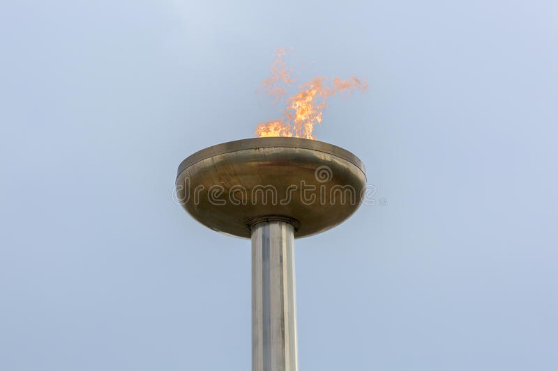 Flaming torch at day time royalty free stock image