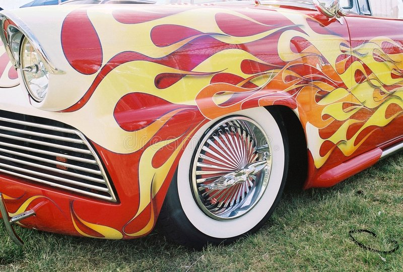 Flaming vintage car w/ naked lady rims royalty free stock images