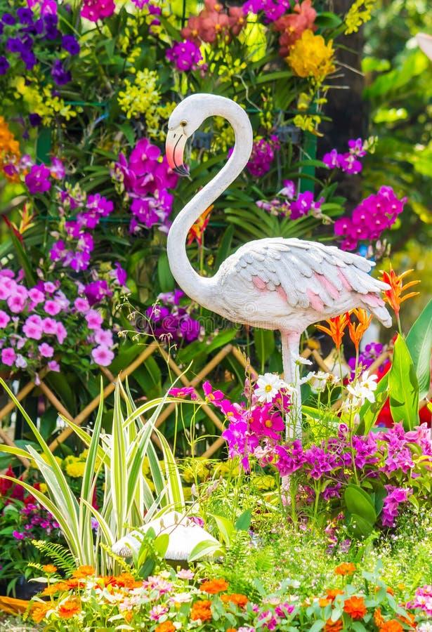 Free Flamingo Bird Statue In Flower Garden. Stock Images - 69497754
