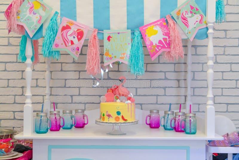 Flamingo cake at the Hawaiian party. Childrens birthday cake at Candy Bar. text Hello spring. Russia, Tatarstan, April 14, 2019 stock photos