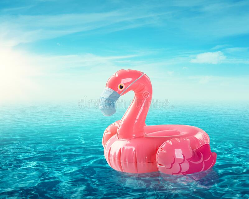 Flamingo toy with medical face mask stock photography