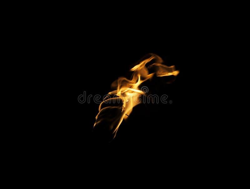 Flamma av en fackla i mörkret royaltyfria bilder