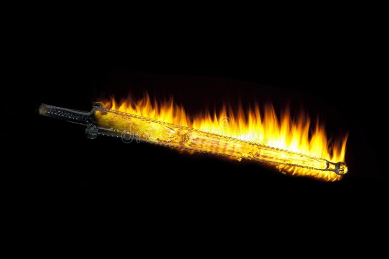 Flammande glass svärd arkivbilder
